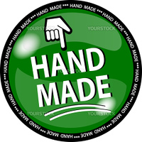 illustration of a green hande made button