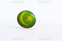 Mauritania flag symbol on thumbtakc on white surface