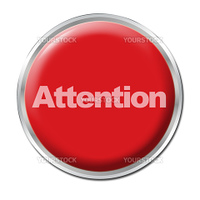 a round red button with a word Attention