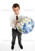 A student schoolboy holds a blow up ball of the Earth.   Pictures of the Earth from Nasa.  Eg, geography, astronomy, travel, environment, geo politics, countries, earth, global and world related issues.