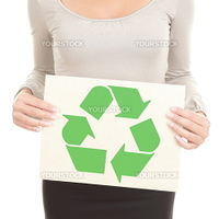 Recycling woman showing the recycle sign / symbol on recycled paper. Isolated on white background.