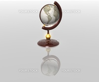 globe on a reflecting surface