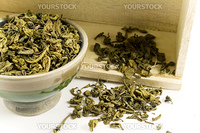 green tea in bowl and wooden box