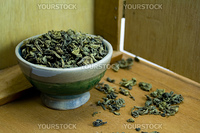 bowl of green tea on background of wooden box
