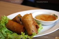 Fried vietnamese spring rolls with traditional greens