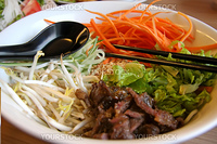 Vietnamese cuisine dish of mixed noodles beef and vegetables