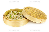 Bamboo steamer with cooked dumplings isolated on white