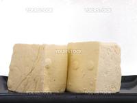 Fresh Chinese tofu. Close up on white background