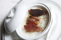 Chinese food, rice with sausage in the bowl.
