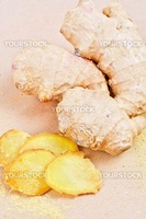 Fresh, dried and powdered ginger at brown background
