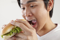 man eating burger on the white background
