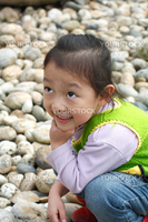 4 year old Chinese girl pretending to be model in a Beijing Park