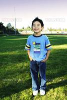 A boy posing at a park