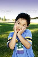 A cute boy posing outdoor