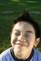 A happy kid daydreaming outdoor