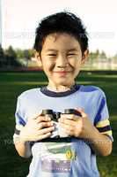 A boy having fun with binoculars