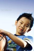 A boy playing basketball outside