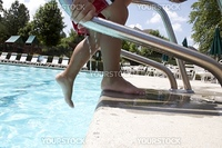 Little boy playing at pool