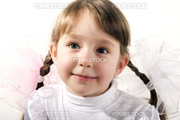 Beautiful little girl with bows smiling