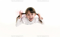 Beautiful little girl with plaits being full of joy