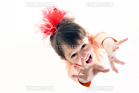Cheerful little girl - view from above