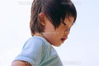 Boy in blue turning around playing.