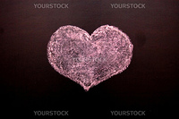 On a blackboard red heart and a word love is drawn