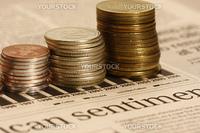 macro shot of Coins on stocks graph