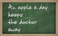 "Blackboard writings "" An apple a day keeps the doctor away """