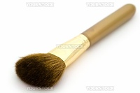 Brush for a make-up on a white background