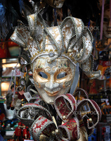 Venetian mask is silver with gold details.