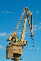 Yellow harbour crane on blue sky background
