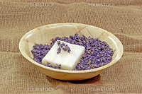 Perfume of lavender and soap on brown Background