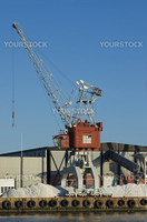 Harbour crane and warehouse at commercial port