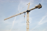 A construction crane isolated on a sky background.