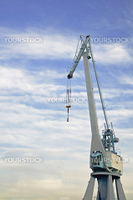 Port crane with blue sky and some clouds