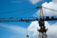heavy industrial crane with blue sky as background