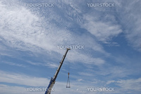 A Mobile Crane Jib against a blue sky