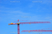 two heavy cranes at a construction site