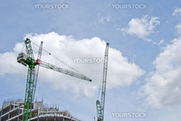 Two Green Heavy Lift Tower Cranes on a construction Site