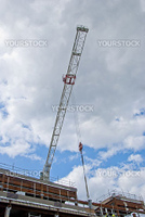 The Jib of a white Construction Crane on a shopping mall site