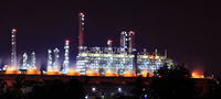 panoramic view of oil refinery factory at night