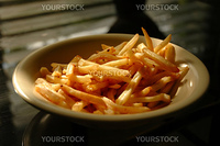 A bowl of french fries on top of table