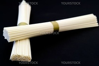 Japanese white wheat noodles on a black background