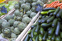 French vegetable market with artichokes, zucchini and salad.