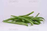 Fresh organic French green beans on white.