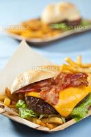 Big cheeseburger with bacon, fries and mayonaise