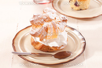 Cream puffs pastry with powdered sugar