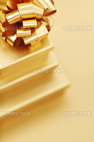 golden christmas gifts on gold background