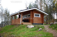 cottage in forest on hill